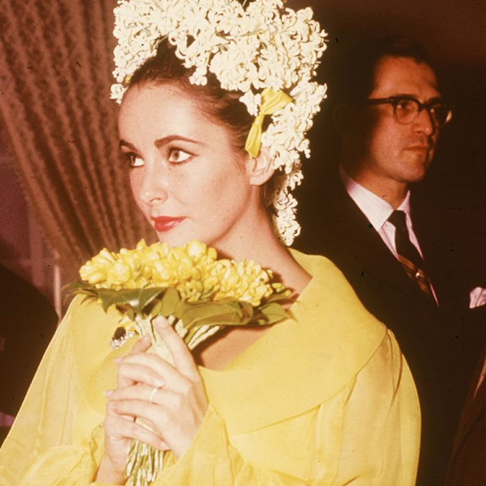best coloured wedding dresses: Elizabeth Taylor in a yellow dress