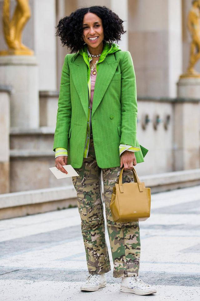 green blazer and camo pants with white sneakers