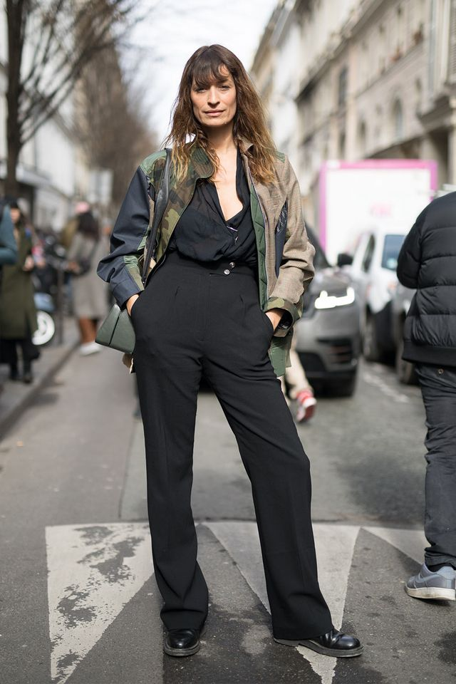 Caroline de Maigret in a camo jacket with a black jumpsuit