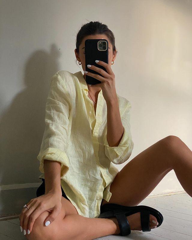 Best Summer Tops: @smythsisters wears a lemon linen shirt