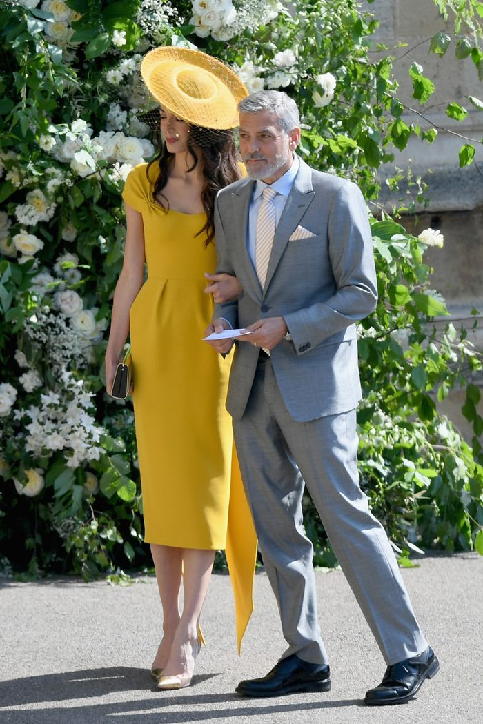 Meghan and Harry's Royal Wedding guests outfits: Amal Clooney in a yellow midi dress and hat