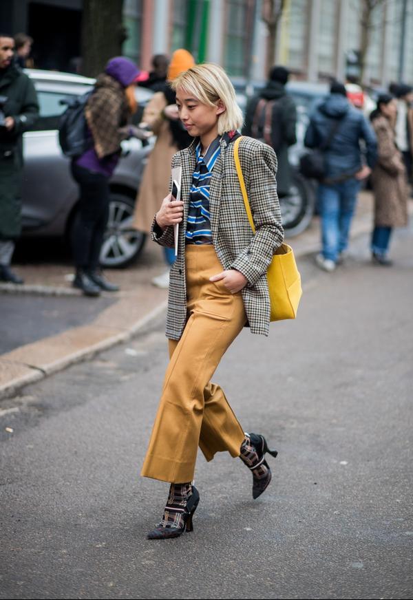 WHO: Margaret Zhang WHAT: Milan Fashion Week WEAR: Plaid jacket