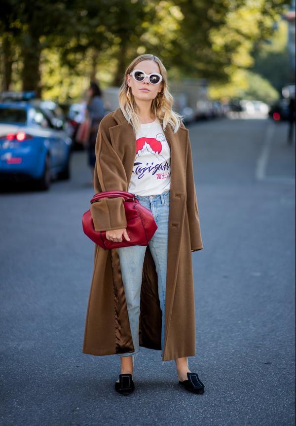 WHO: Jessie Bush WHAT: Milan Fashion Week WEAR: Max Mara jacket, Topshop jeans, Marni shoes