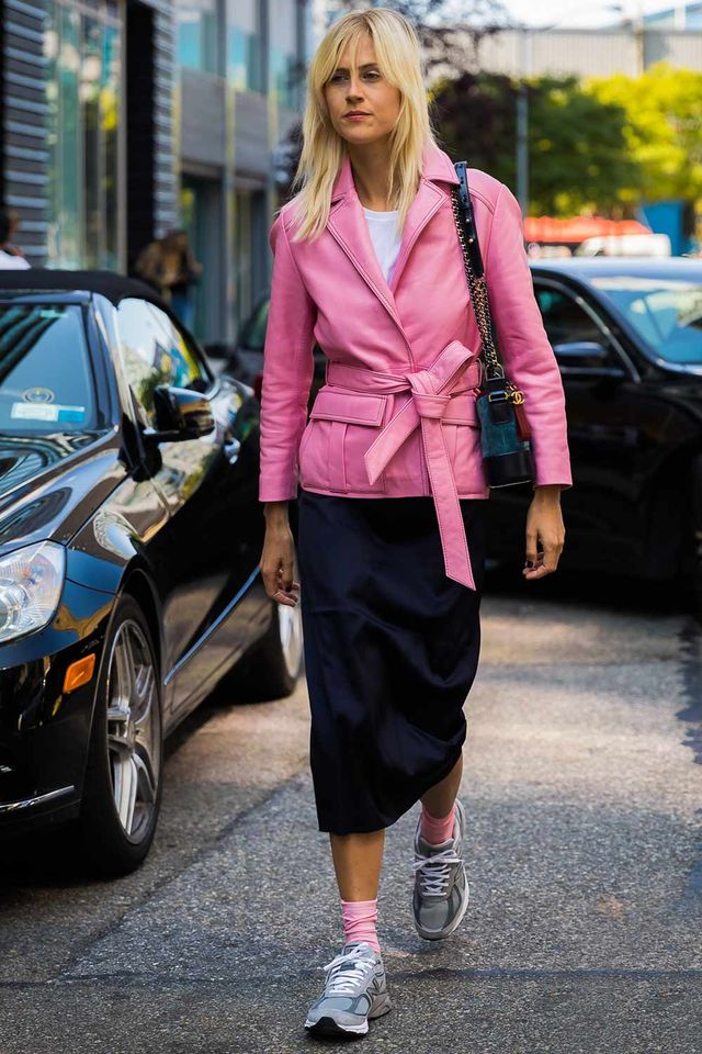 Linda Tol in a pink blazer