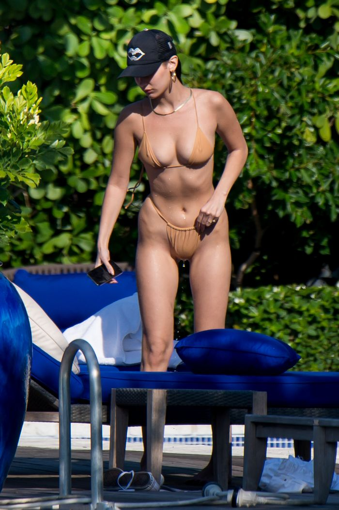 Bella Hadid wearing a nude swimsuit