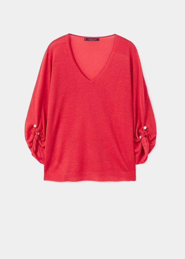 Piercing detail sweater