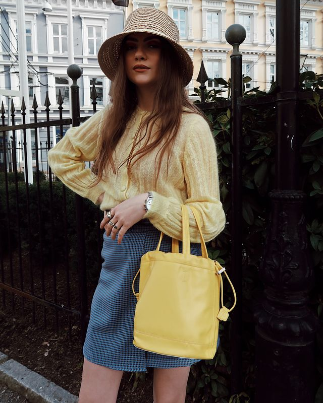 Match yellow's playfulness with equally fun accessories like a bucket hat.