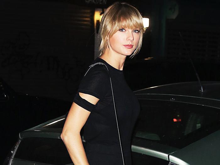 Taylor Swift wearing a black dress