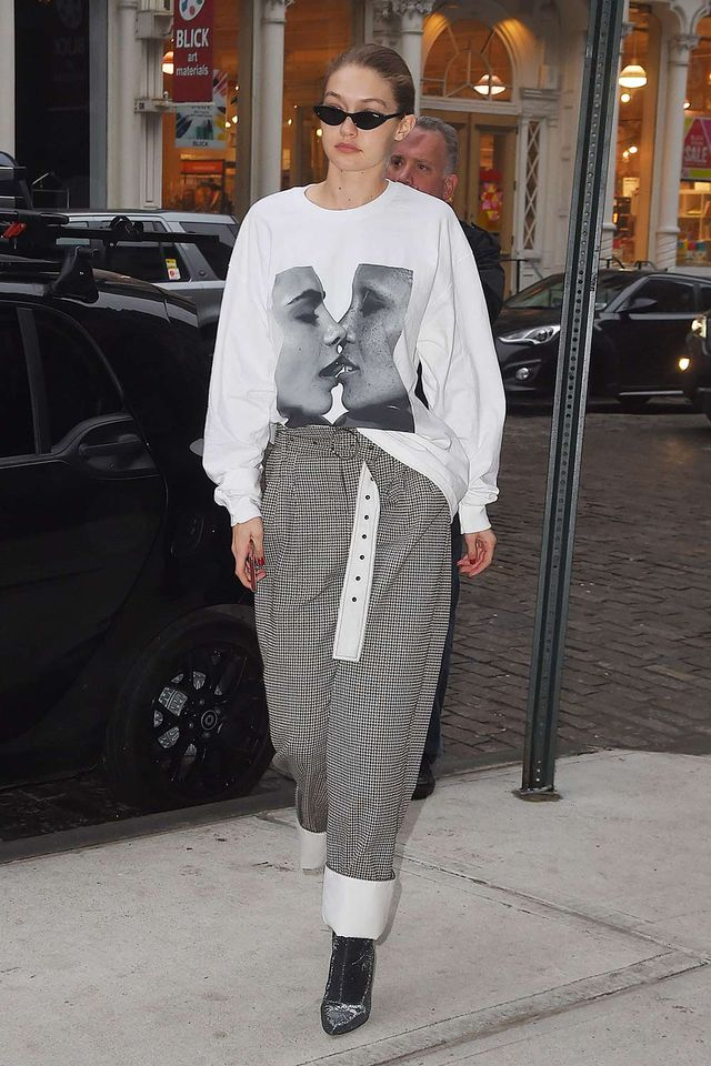 Gigi Hadid in graphic top and wide-leg pants