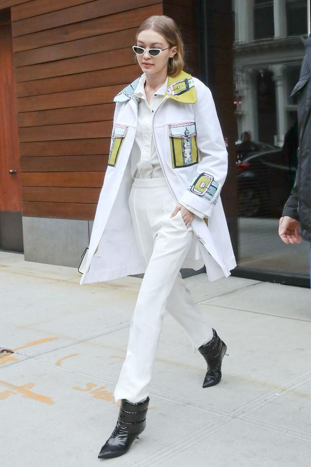 Gigi Hadid in a white coat and white pants