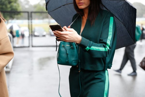 WHO: Tahnee Atkinson STYLE TIP: A lesson in how to wear a matching tracksuit and still look chic? Add a tonal mini-bag to match.