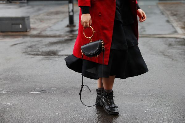 STYLE TIP:Combat boots and a mini purse elevate a classic black dress.