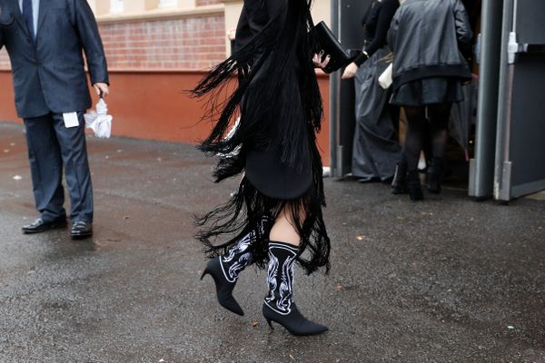 WHO: Isabella Manfredi STYLE TIP: This look incorporates two trends at once: The fringed skirt and western boot look unexpected but chic when paired in the same colour.