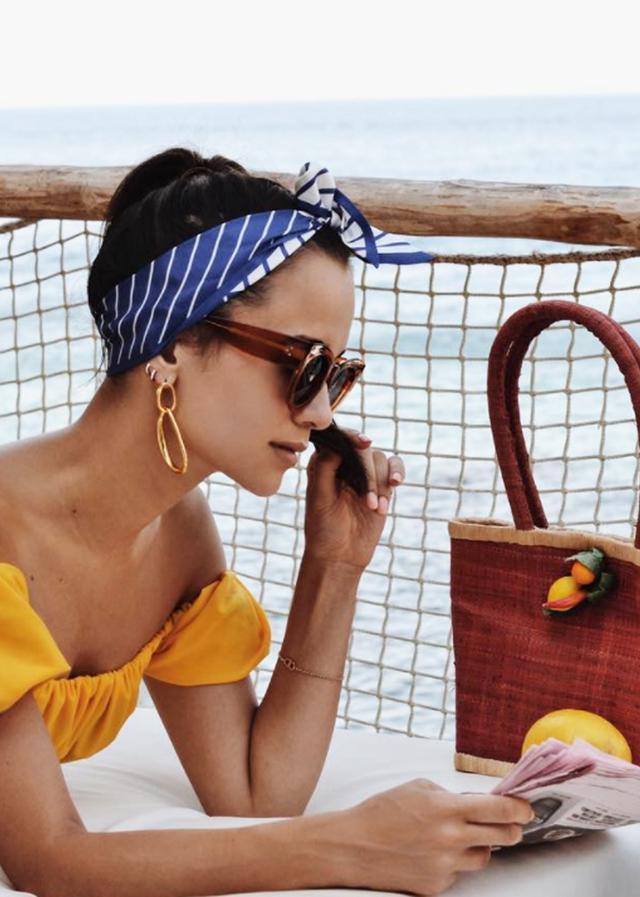Beachwear trends: Anna Vitiello with lemon bag and yellow bikini