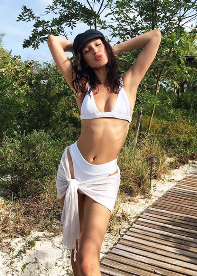 Beachwear trends: Bella Hadid in white bikini and sarong