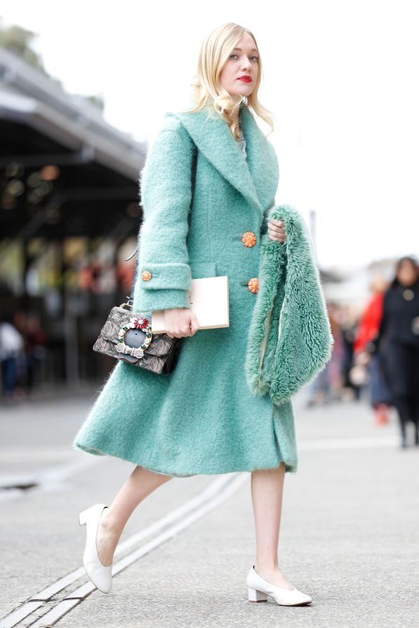 STYLE TIP:This colour-coordinated fur stole is perfectly balanced out by the stark white shoes and classic Gucci bag.