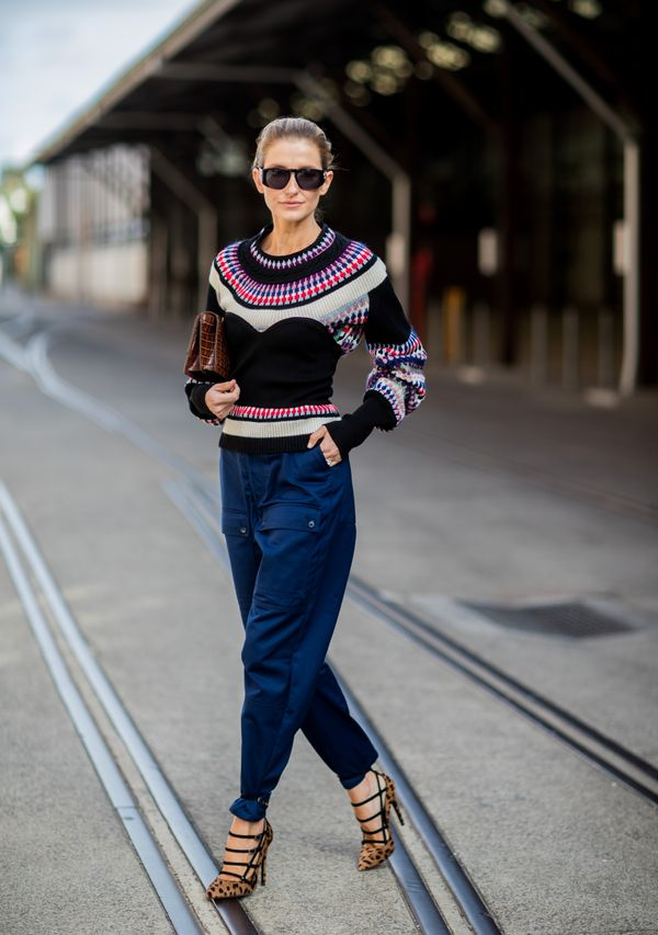 WHO: Kate Waterhouse STYLE TIP: Pair multiple statement pieces together for an ultra-chic look. This detailed jumper combined with the leopard print heels stands out in a good way.