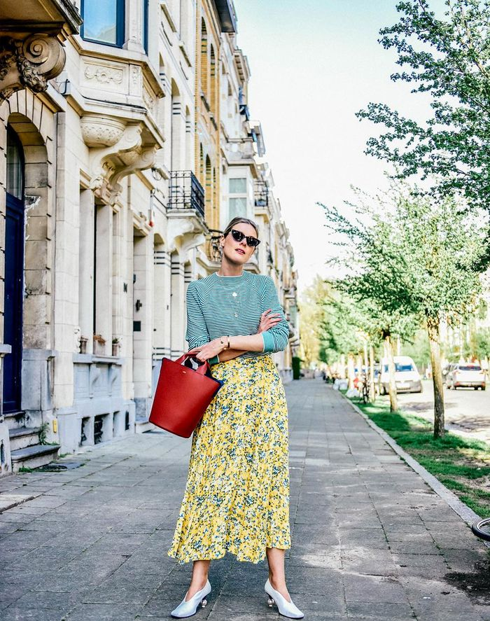 Best Midaxi Skirts and Dresses: Sofie Valkiers in a Yellow Floral Skirt