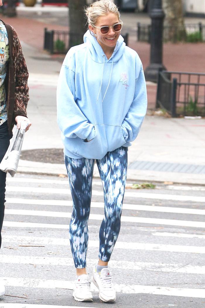 Sienna Miller wearing printed leggings