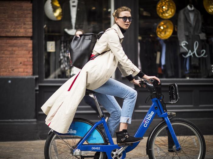 work backpack: Karlie Kloss on a bike