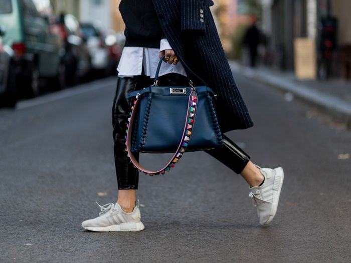 stylish running sneakers: leather pants and a Fendi bag
