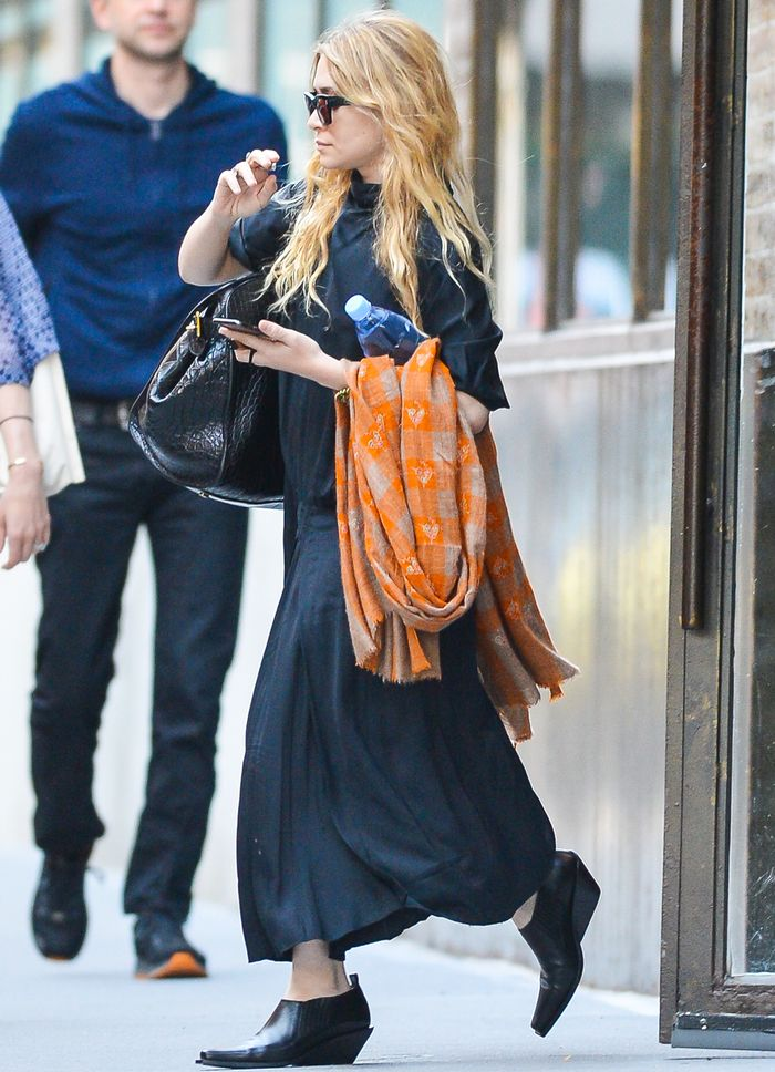 Ashley Olsen in Wedge Ankle Boots