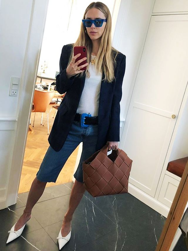 how to wear shorts:  try skinny long denim shorts with a blazer and pointed-toe shoes