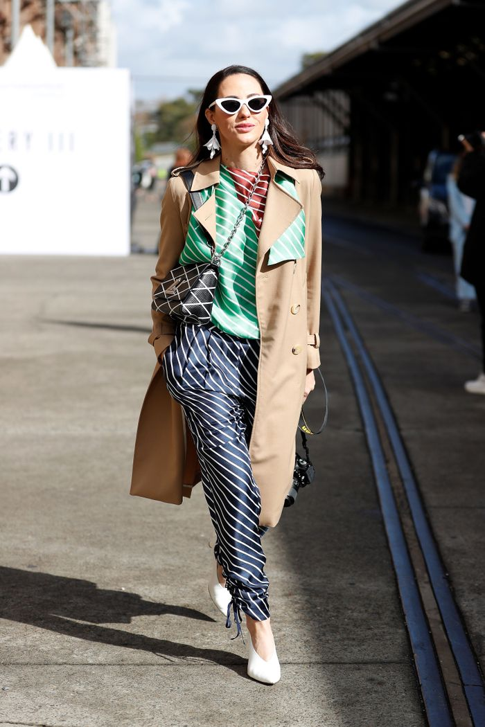 Street style trench coat and Louis Vuitton bag