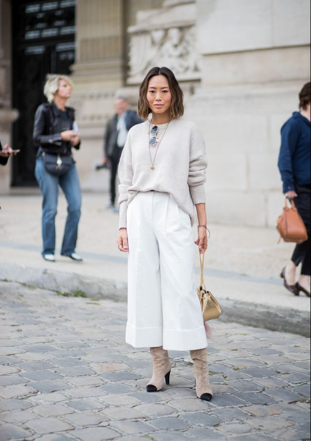 Thiswhite pant and sweater combo proves that the old rule of avoiding the light trousers during the colder is one that should be ignored. By pairing her camel sweater with white trousers and...