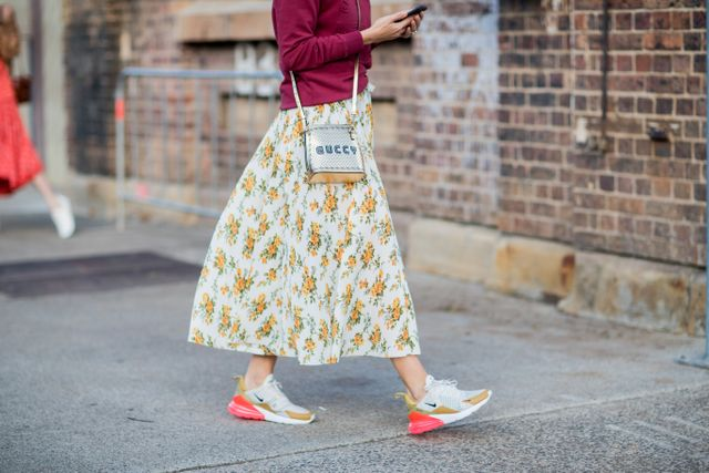 """Anything goes this season, and unique combinations (such as skirts with sneakers) are proving that there's no such thing as """"too much"""". We'd even encourage you to add in a..."""