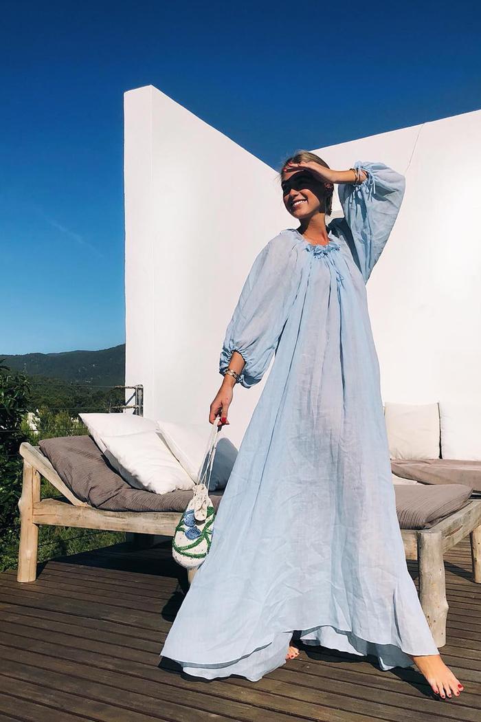 Best beach dresses: Emili Sindlev wearing a blue maxi kaftan from Three Graces London