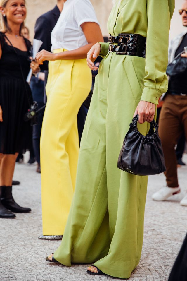 Style notes: A thick waisted belt will add shape to an oversized romper. We'll be copying this exact look this winter, but maybe we'll swap the sandals for boots.