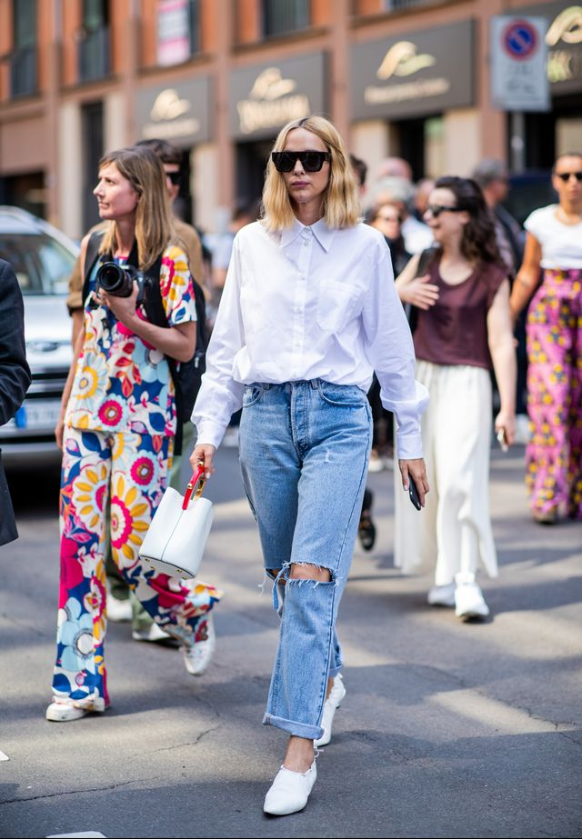 Style notes: Ripped blue jeans and a crisp white shirt are staples in our winter wardrobes already, but the addition of the white bag and shoes makes this really fresh.