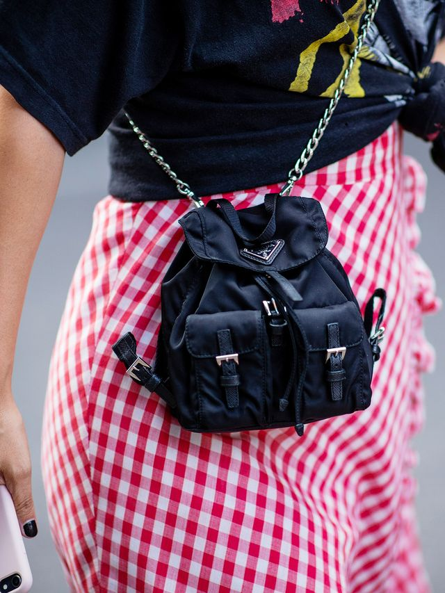 Style notes:Sick of wearing your backpack on your back? Detach the straps, add a chain, and wear it as a cross-body bag instead.