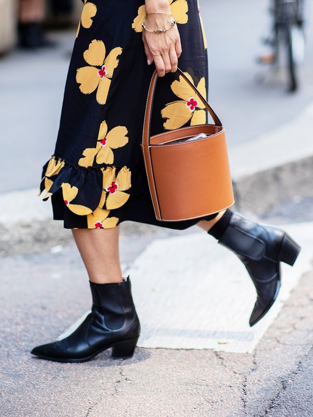 Style notes: A midi-length printed dress andblack ankle boots is the perfect combination for the office, the bar, and everywhere in between.