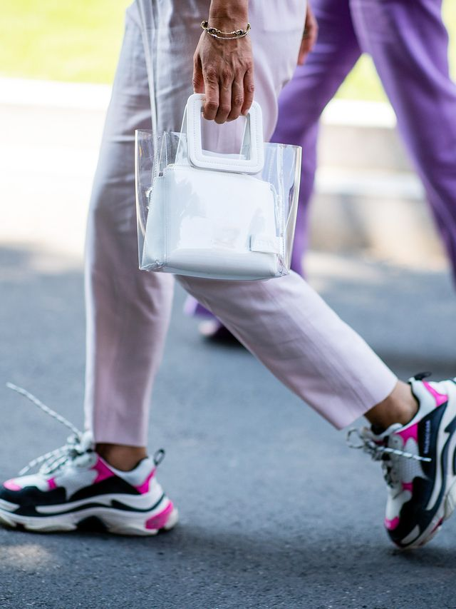 Style notes: Instead of going for all-white sneakers this season, opt for a pair with bright accents, and then match them with cropped trousers.
