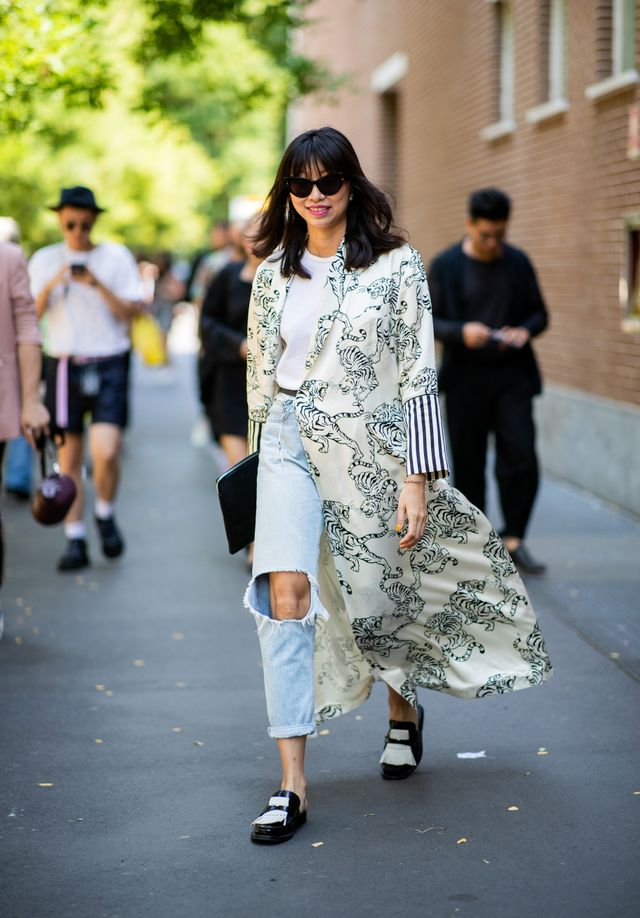 Style notes: Here's another idea for bringing your summer wrap dresses into the cooler weather: Layer them over a classic jeans-and-tee combo and tie it loosely for an effortless effect.