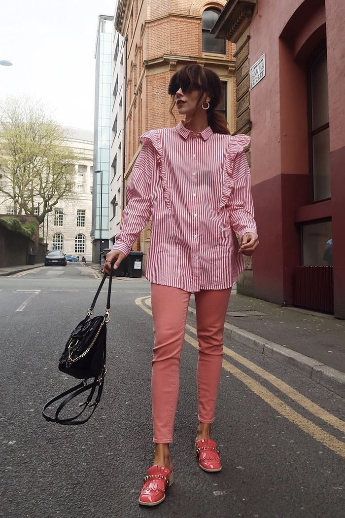 Monki Clothing: Megan Ellaby in a pink stripy shirt and pink jeans