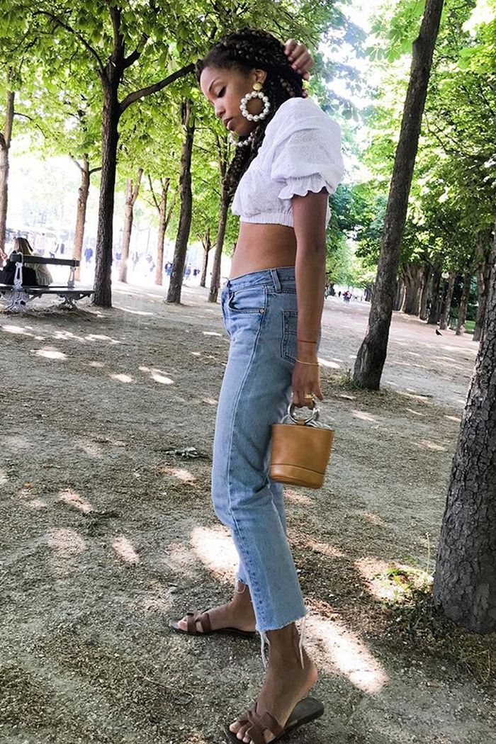 crop top and jeans: slip into style wearing white crop top and faded jeans