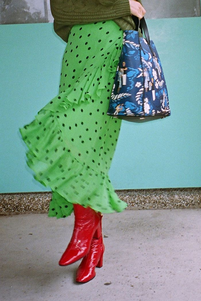 Green outfits to achieve your green aesthetic: Ganni's green polka-dot skirt is trending