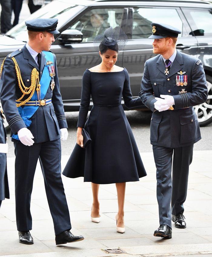 Meghan Markle boat neckline: Wearing black Dior dress With Prince Harry