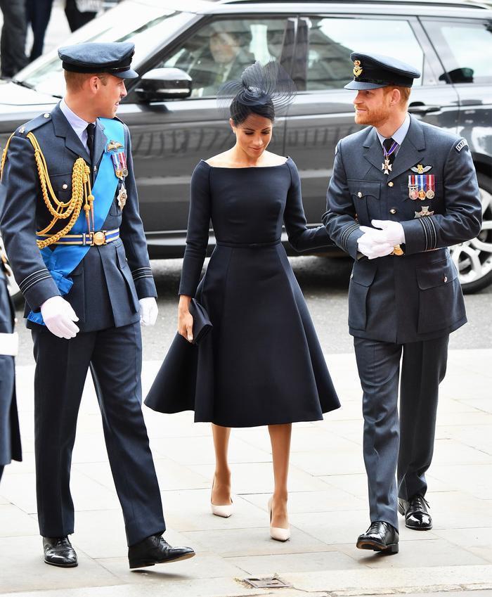 Meghan Markle boat neckline: Wearing black Dior dress With Prince Harry