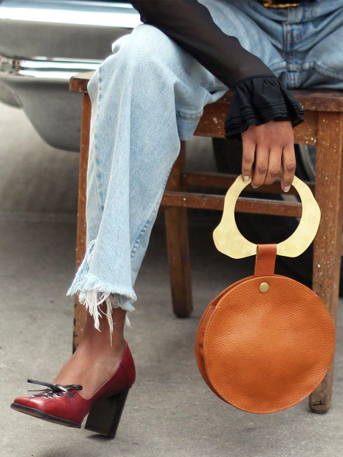 Noa Vee: Brown Edas jewels handbag worn with jeans