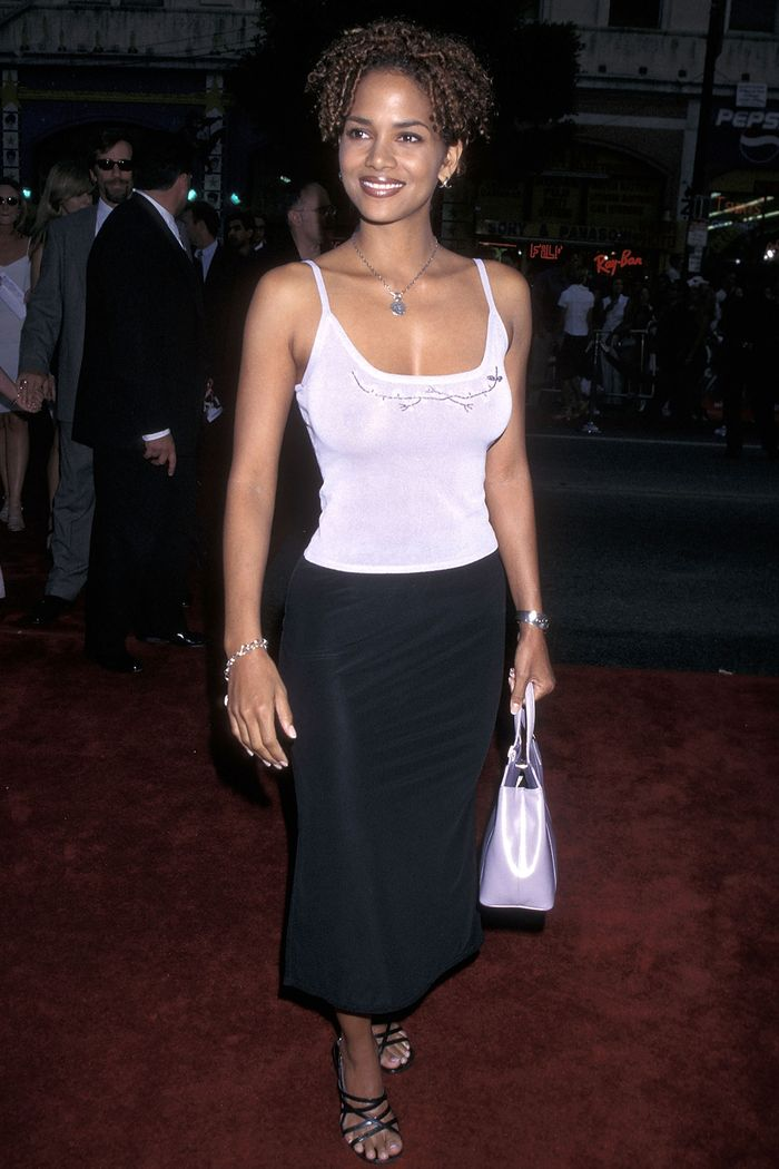 best summer outfits 90s: Halle Berry wearing vest top and black skirt