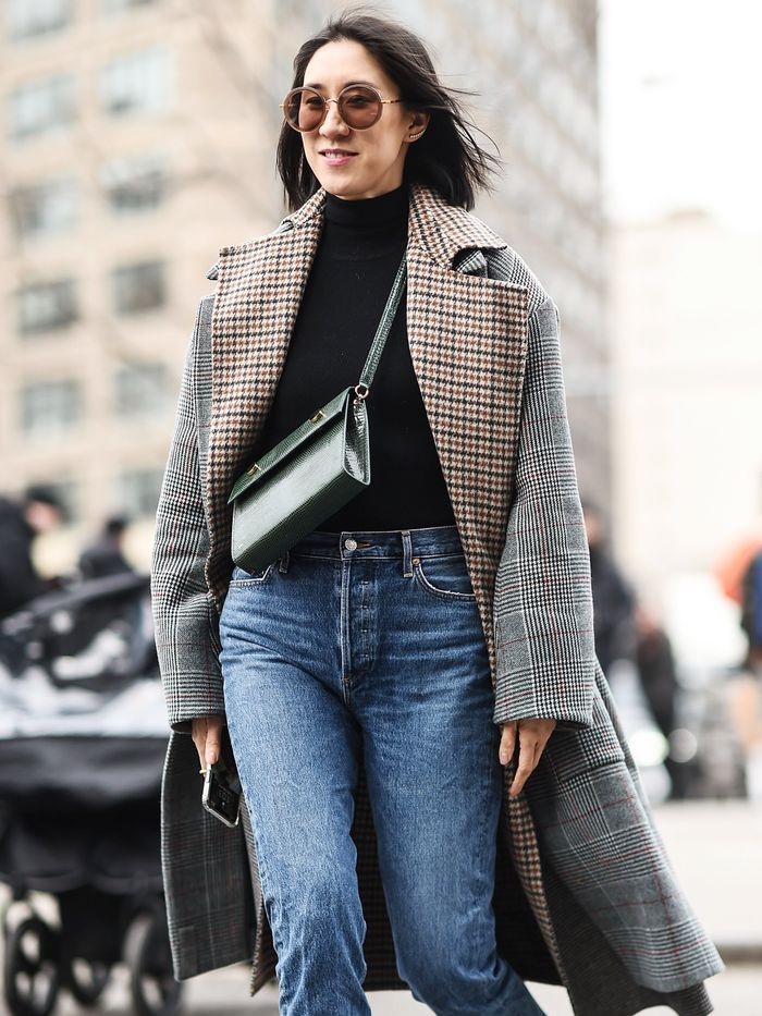 Eva Chen wearing a checkered coat and jeans