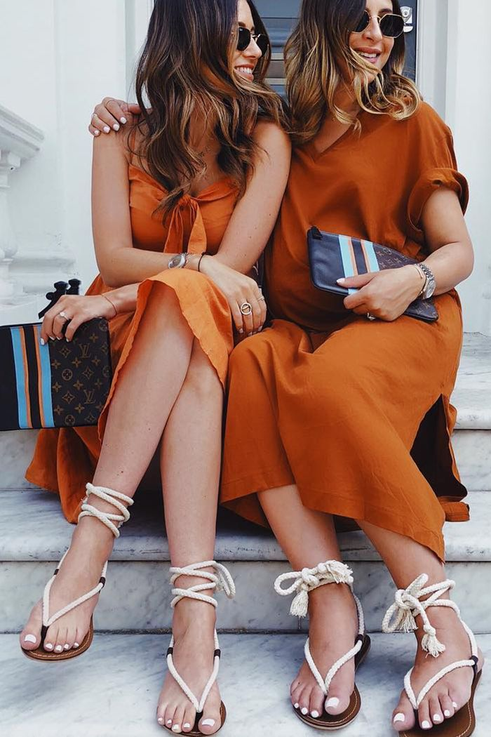 Terracotta outfit ideas: We Are Twinset wearing terracotta dresses