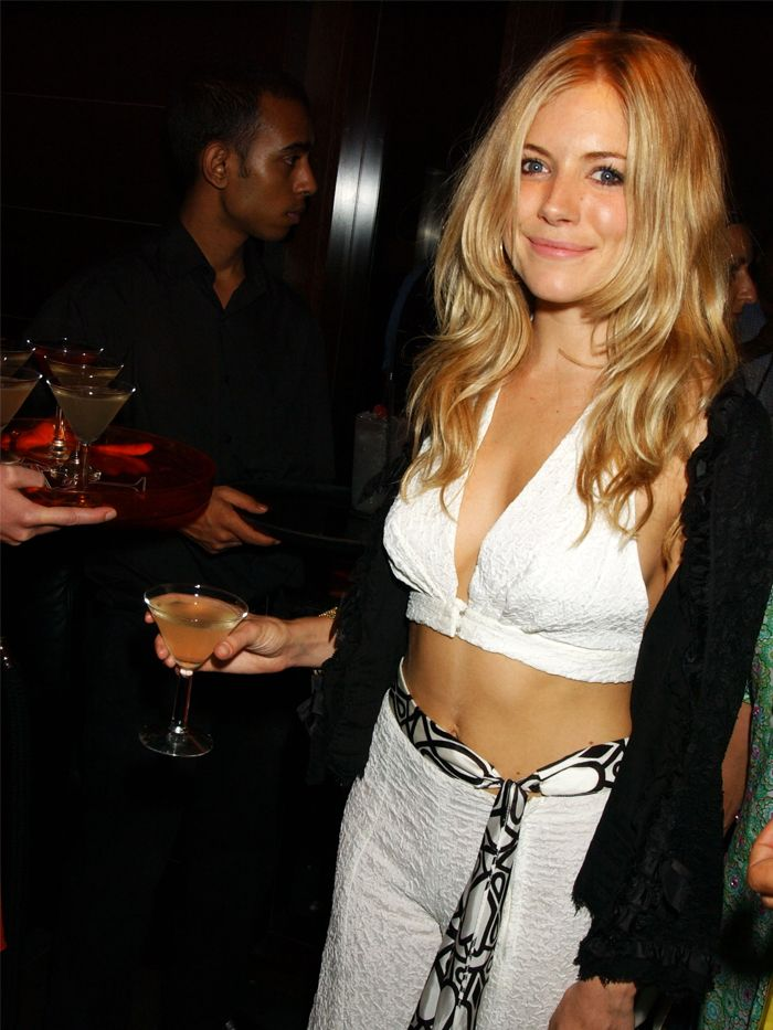 Sienna Miller Style 2000s: Sienna wears a crop top and fabric belt