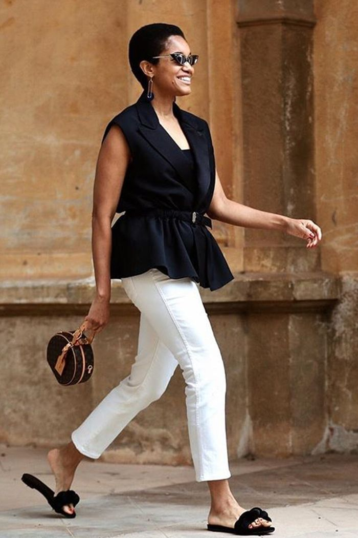 Corporate office summer dress code: Tamu McPherson wears white jeans with a black tailored top