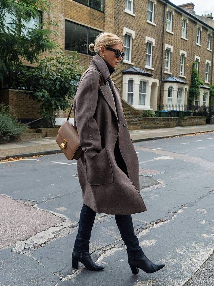 Emma Hill wears H&M brown coat over black polo and jeans with Celine bag.