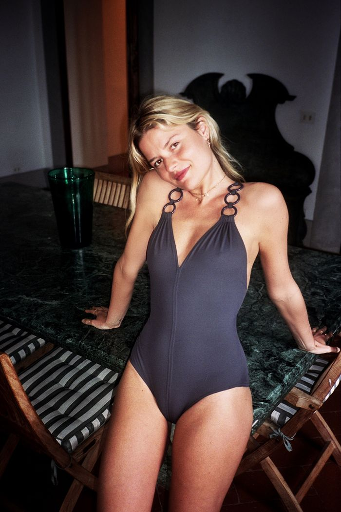 French swimsuit trends: Sabina Socol wearing Eres black swimsuit